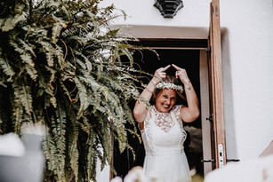 bride walking out of hotel room giving the finger laughing fun bride