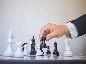 depositphotos_316728732-stock-photo-businessman-hand-moving-chess-piece.jpg