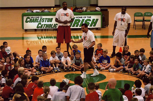 coach greg white speaking to campers