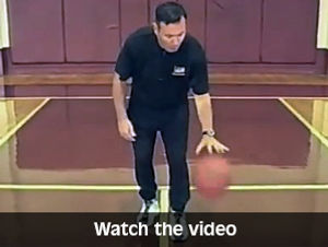 coach white teaching dribbling