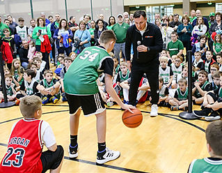 coach greg white instructing at basketball camp
