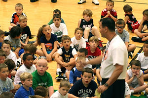 kids listening to Coach white during teaching
