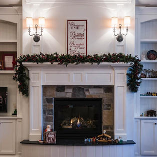 Beautiful white mantle with bookcases