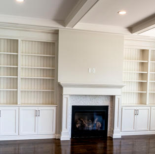 Mantle with bookcases and beadboard panels