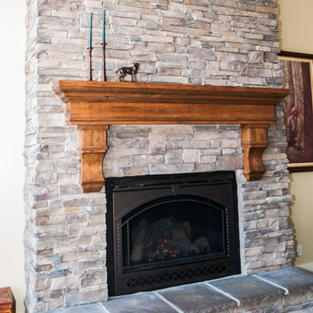 Slab style mantle with corbels