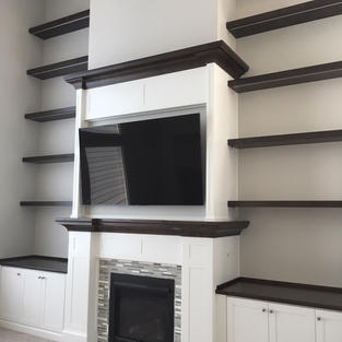 Contemporary mantle and floating shelves