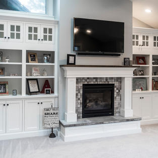 Mantle with bookcases and hearth