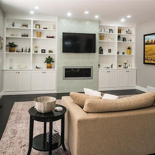Built-in white painted bookcases