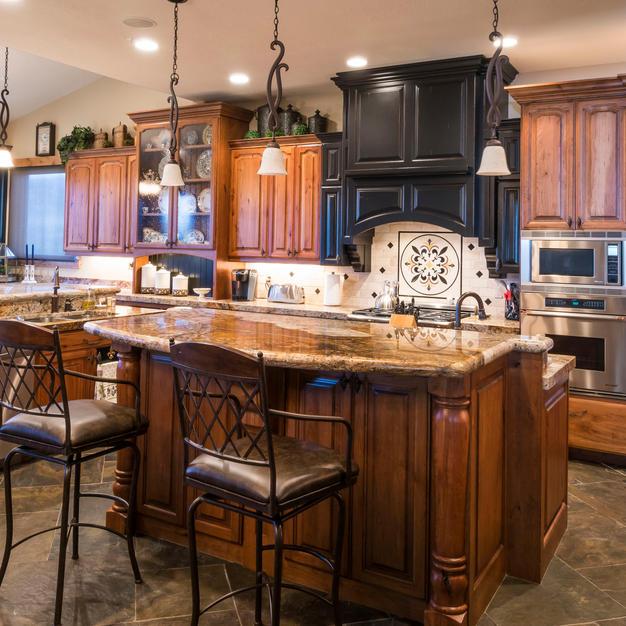 Cherry kitchen with black hood