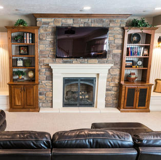 Two-tone mantle and bookcases