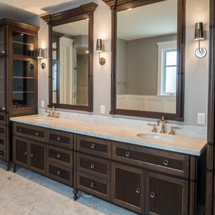 Walnut vanity with glass linens.