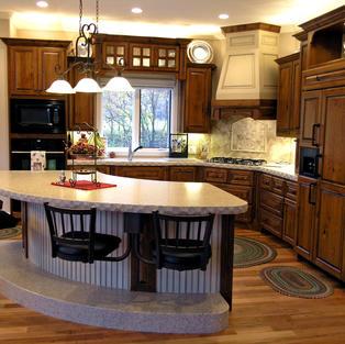 Cherry kitchen with 1/4 round island