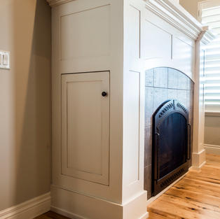 White mantle with integrated cabinet