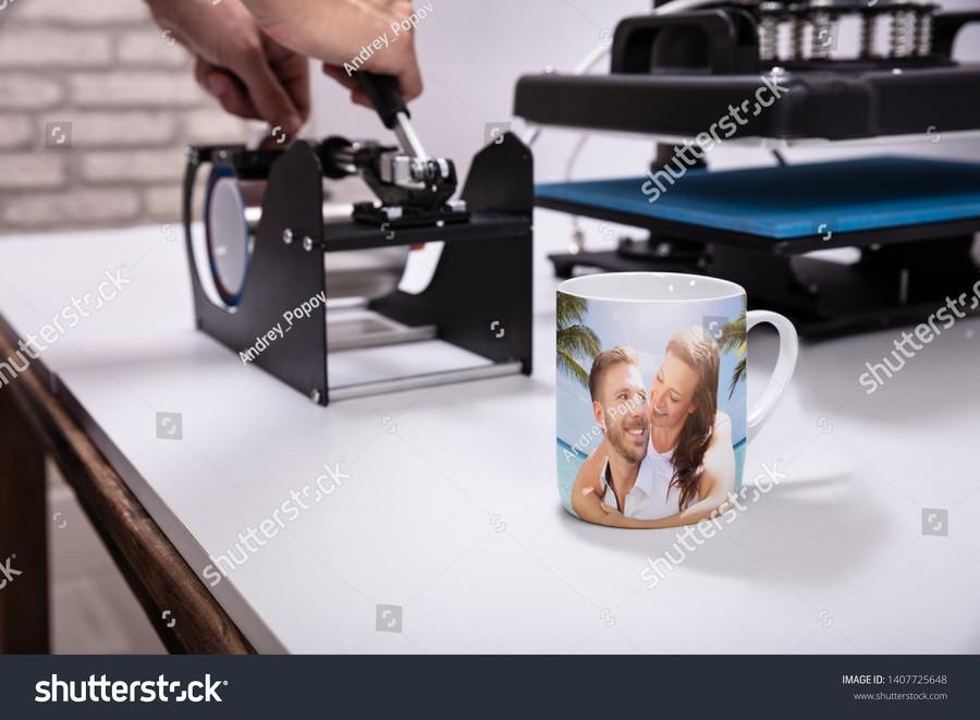 stock-photo-man-printing-on-coffee-mugs-