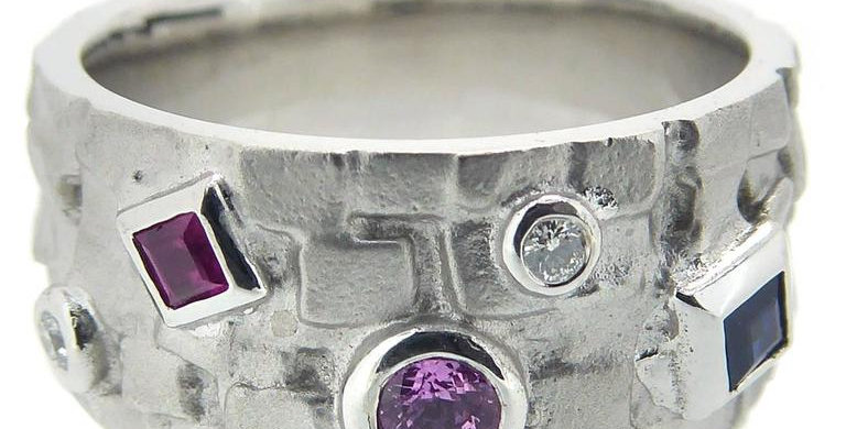 Modern white gold band with multicolour gemstones