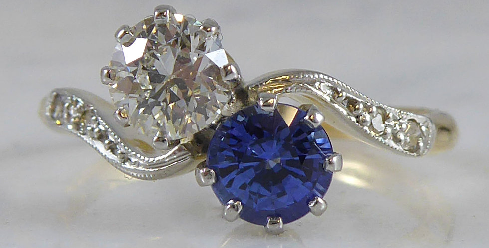 Vintage sapphire and diamond ring, two stone twist with diamond shoulders, front view