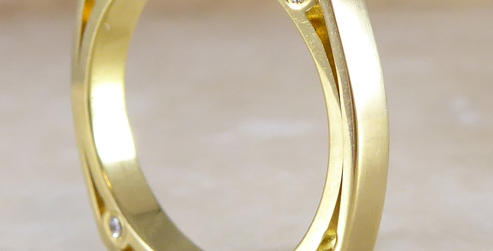 Arts and Crafts style wedding ring, angled view showing diamonds