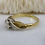 Side view of vintage diamond ring with fancy shoulders and gold band