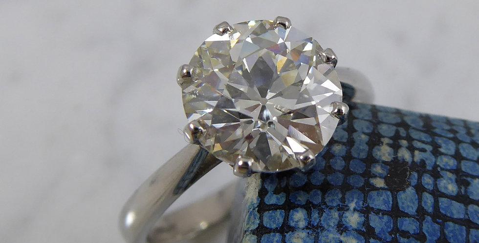 Large antique diamond next to antique blue ring box