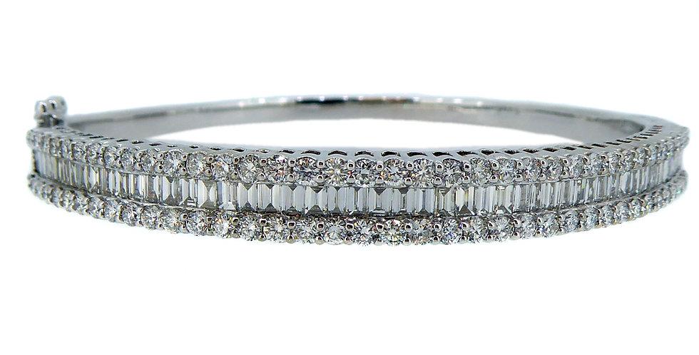 Modern diamond bangle with brilliant cut and emerald cut diamonds in 18ct white gold