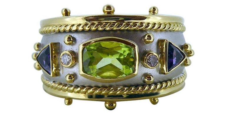 Contemporary Peridot, Amethyst and Diamond Ring, 18ct Gold Band, London 1995