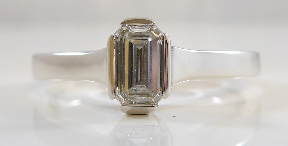 Contemporary Engagement Ring Set with Emerald Cut Diamond in 18ct White Gold