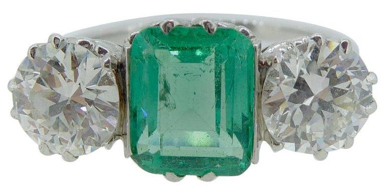 1.28 Carat Emerald and Diamond Ring in Three-Stone Platinum Mount, circa 1950s