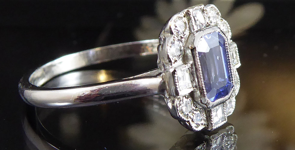 Art Deco style sapphire and diamond cluster ring, showing white gold band