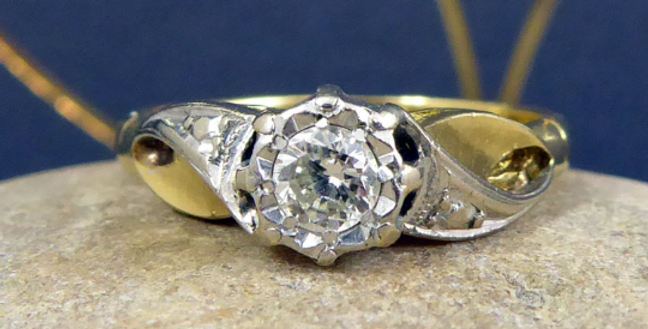 Vintage solitaire ring with fancy shoulders and gold band