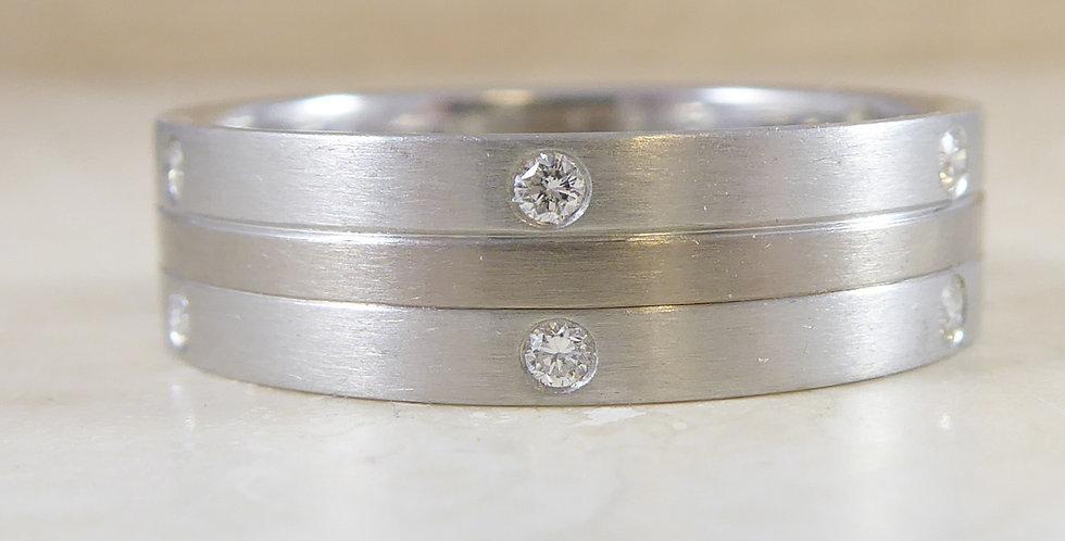 Modern platinum and white gold diamond wedding ring