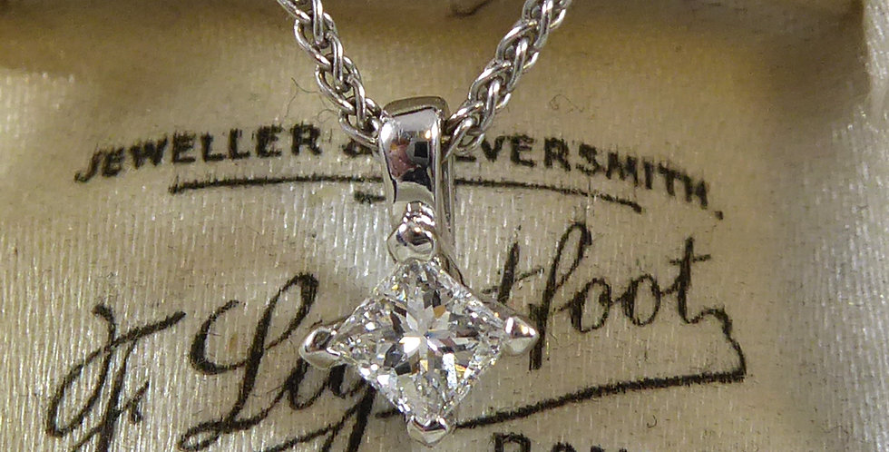 Modern princess cut diamond solitaire pendant on white gold chain