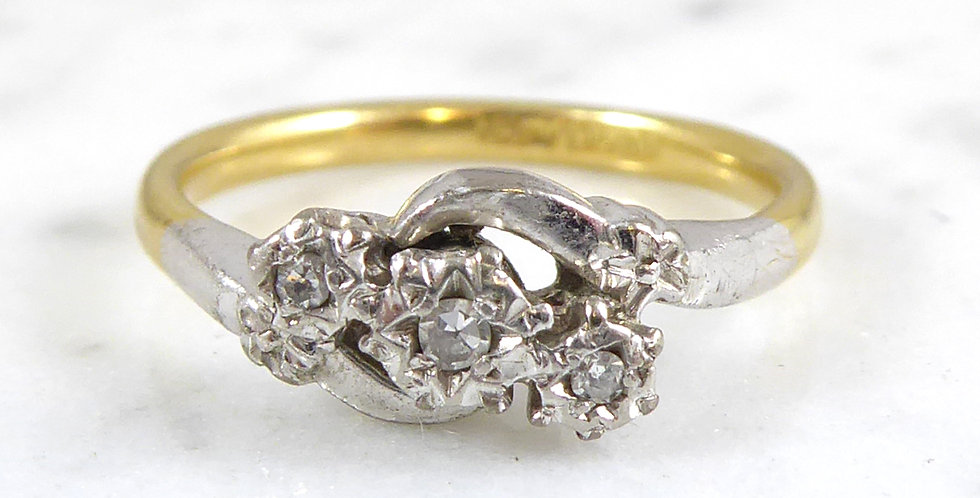Vintage Engagement Ring set with Three Diamonds in a Cross Over Twist Style