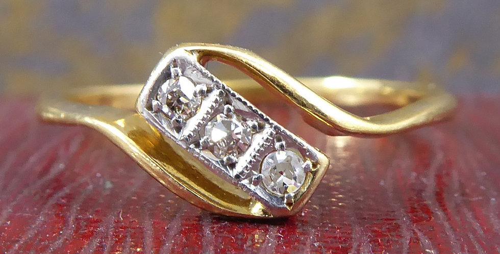 Art Deco Engagement Ring set with Three Diamonds in Rectangular Cross Over Twist