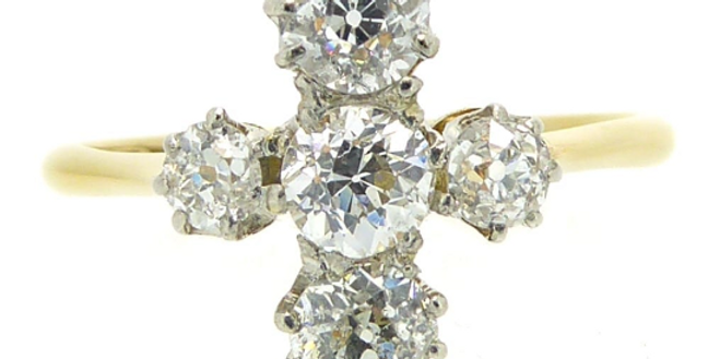 Antique diamond ring in a cross shape on yellow gold band