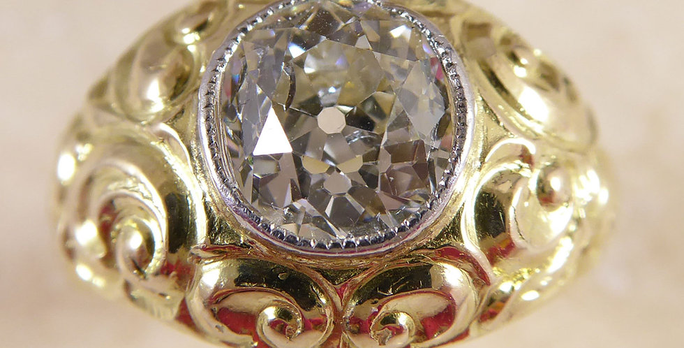Antique diamond solitaire ring in ornate yellow gold mount