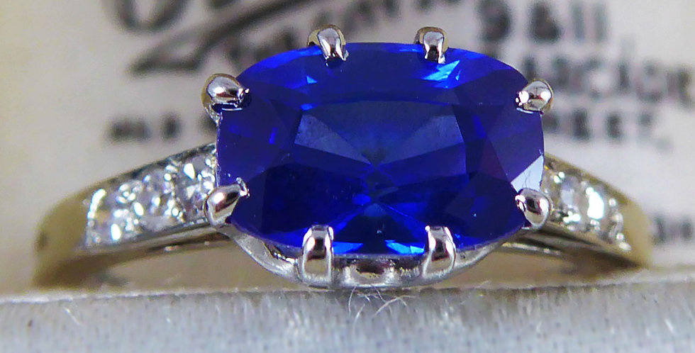 Contemporary 1.41 Carat Sapphire Ring with Diamond Set Shoulders, French