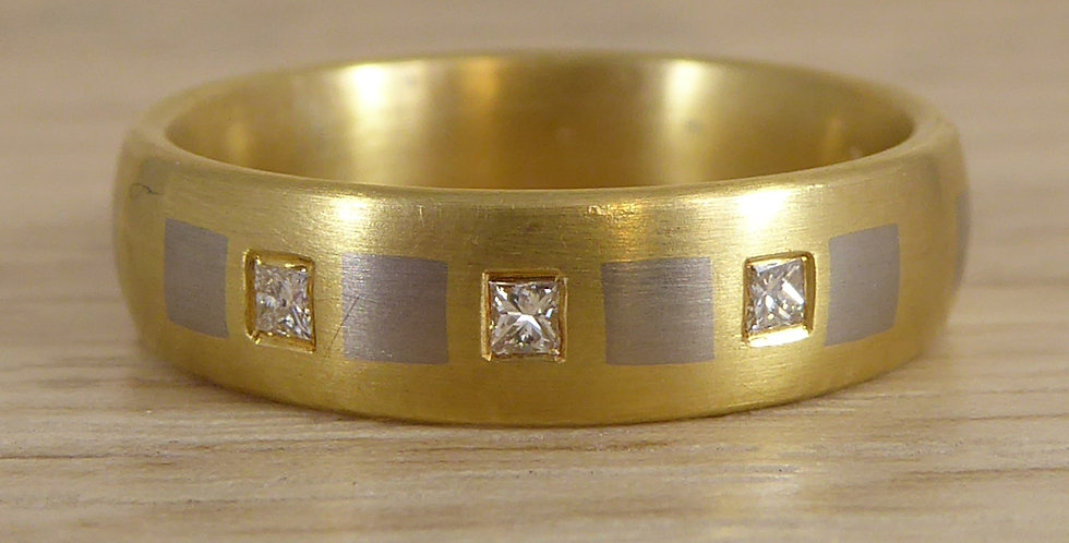 Designer diamond wedding band in platinum and yellow gold front view