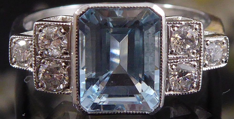 Emerald cut aquamarine ring in Art Deco style with diamond set shoulders, front view
