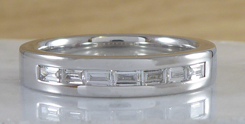 Contemporary baguette diamond eternity ring front view