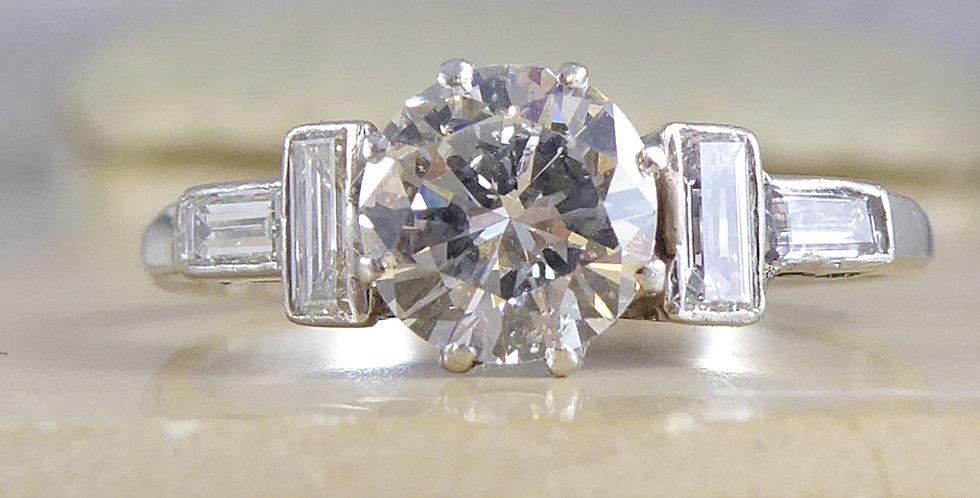 Art Deco diamond ring with baguette diamond shoulders