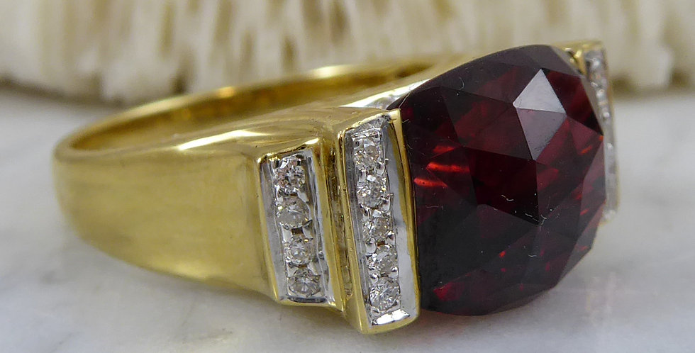 Vintage Garnet ring with diamond set shoulders and yellow gold band