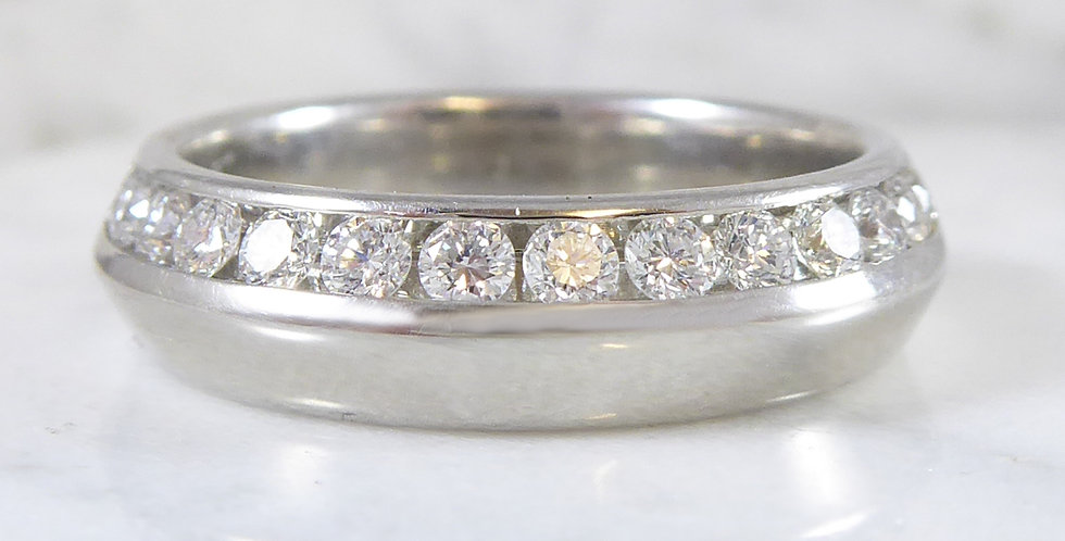 Contemporary platinum and diamond ring front view