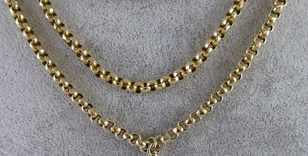 Victorian gold long chain close up view from front