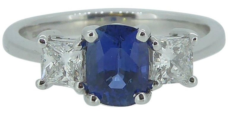 Traditional Style Sapphire and Diamond Three Stone Engagement Ring