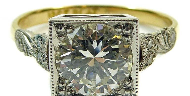 Vintage engagement ring with old cut diamond in a square setting