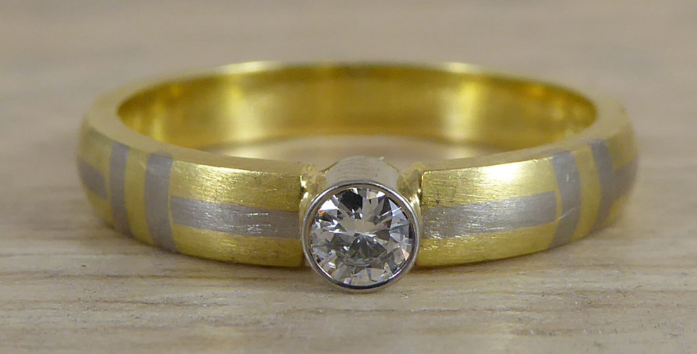 Modern engagement ring showing the diamond from the fron