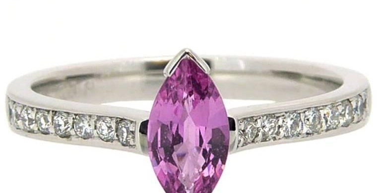 Modern pink sapphire ring with diamond band