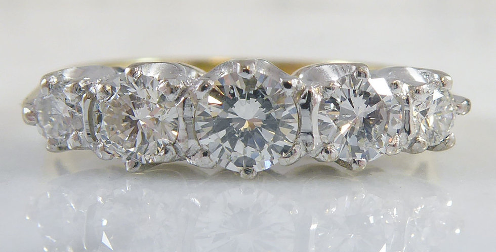 Vintage diamond ring with five diamonds in a row, front view