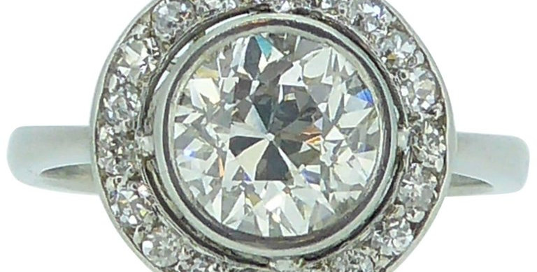 Art Deco diamond ring with halo surround, front view