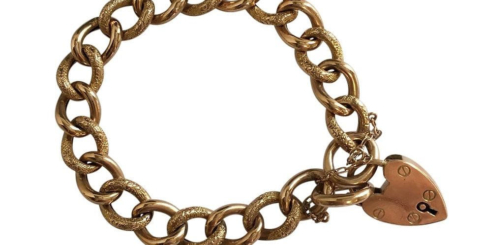 Antique gold curb link bracelet with gold padlock
